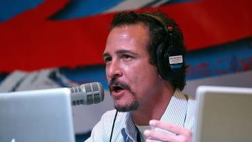 Feb 1, 2012: Radio personality Jim Rome performs on his show at radio row prior to Super Bowl XLVI at Lucas Oil Stadium.