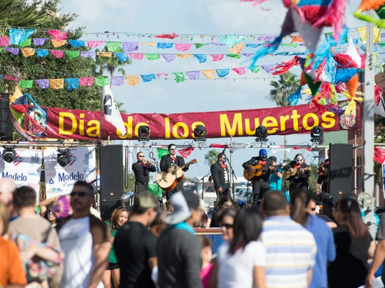 A mariachi band plays on the main stage during the annual Dia De Los Muertos Festival in Corpus Christi.
