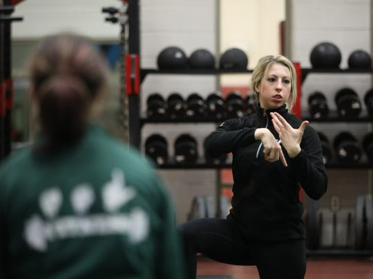 Janna Luksha, who is deaf, is a certified personal trainer. She instructs a class using American Sign Language at the Penfield YMCA.