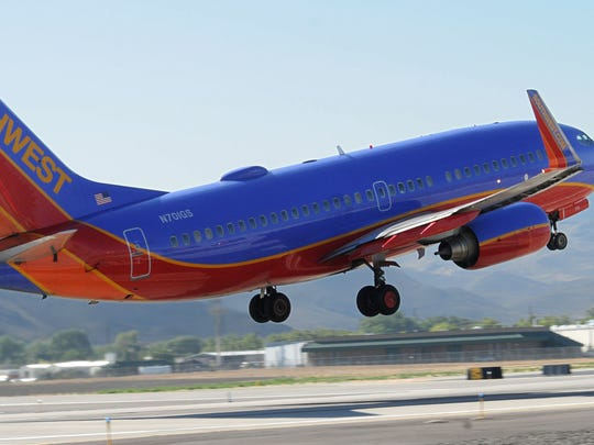 A Southwest Airlines plane takes off from Reno-Tahoe International. Baggage handlers for the airline are protesting the company's slide in on-time performance and languishing contract negotiations.