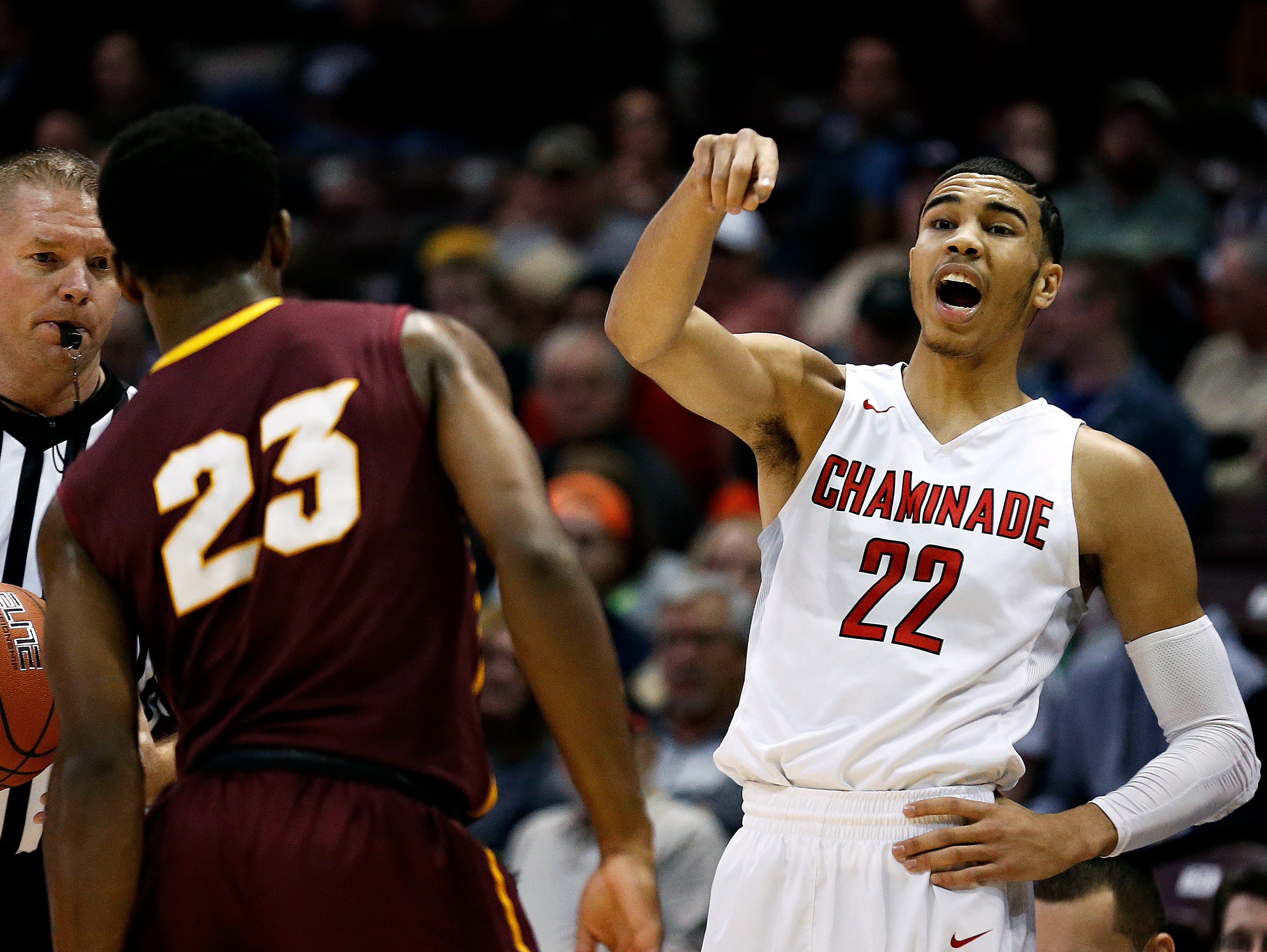 Chaminade College Preparatory School forward Jayson Tatum (22) yells out instructions to his teammates during first quarter action of the 2016 Tournament of Champions first round game between Chaminade College Preparatory School (St. Louis, Mo.) and Christ The King High School (Middle Village, N.Y.) at JQH Arena in Springfield, Mo. on Jan. 14, 2015. The Chaminade Red Devils won the game 67-48.