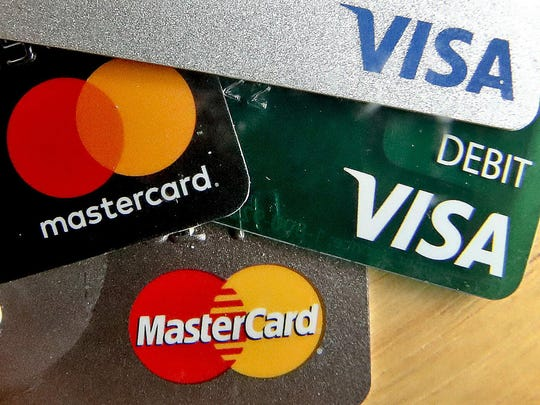 In this Feb. 20, 2019, logos for credit cards are visible on the cards in Zelienople, Pa. On Tuesday, May 7, the Federal Reserve releases its March report on consumer borrowing.