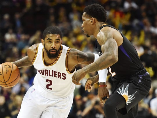 Cleveland Cavaliers guard Kyrie Irving (2) drives to