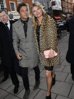 Kate Moss and Jamie Hince arrive at Mayfair restaurant in London to celebrate her 40th birthday.