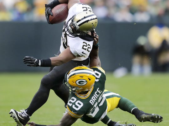 Green Bay Packers defensive back Kentrell Brice (29) is callled for a horse collar while tackling New Orleans Saints' Mark Ingram (22) on Sunday, October 22, 2017, at Lambeau Field in Green Bay, Wis. The Saints defeated the Packers 26 to 17.