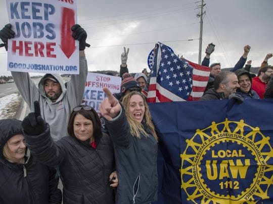Amy Drennen, center, of Lordstown, Ohio, an employee at General Motors for 12 years, gathers with other supporters and laid off workers outside General Motors assembly plant, Wednesday, March 6, 2019, in Lordstown, Ohio.