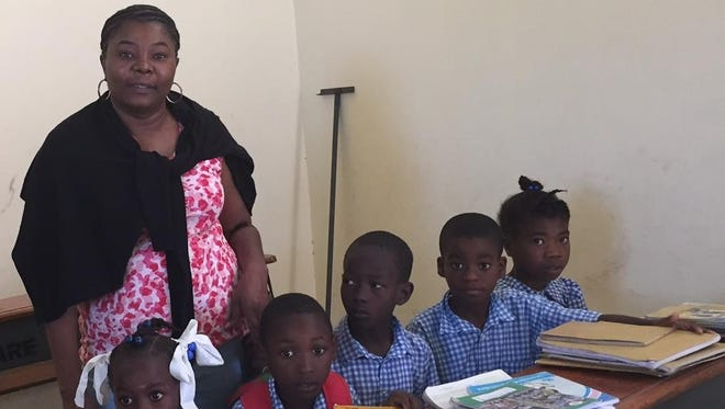 "Beatrice Marseille of Spring Valley works with young students and donates books through her ""Textbooks for 851 primary school children in Haiti"" program."