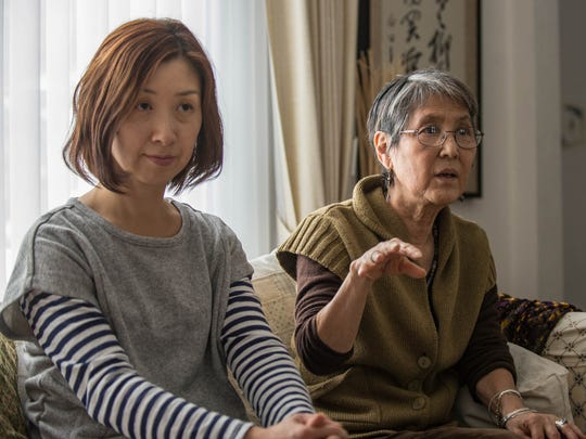 Takako Mizuta, right, has lived in Battle Creek for 19 years and has helped Sachiko Miki, Naho's mom, get acclimated to American culture.
