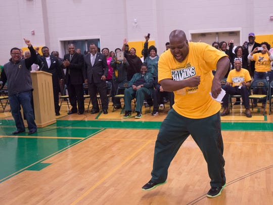 "G.W. Carver coach James ""J.J."" Jackson dances."