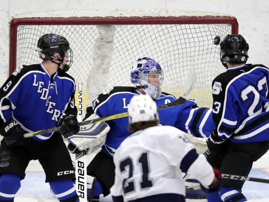 A shot from Hudson's Cole Danielson gets past Saint Mary's Springs Colin Ahern for a goal during the WIAA state quarterfinals Thursday at the Veterans Memorial Coliseum in Madison.