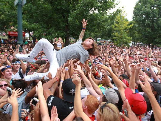 Oliver Feighan, one of the two members of the Philadelphia Rap group OCD, crowd surfs Saturday at Made In America concert on the Benjamin Franklin Parkway in Philadelphia.