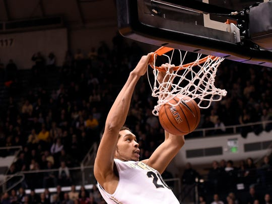 Purdue center A.J. Hammons dunks in the first half