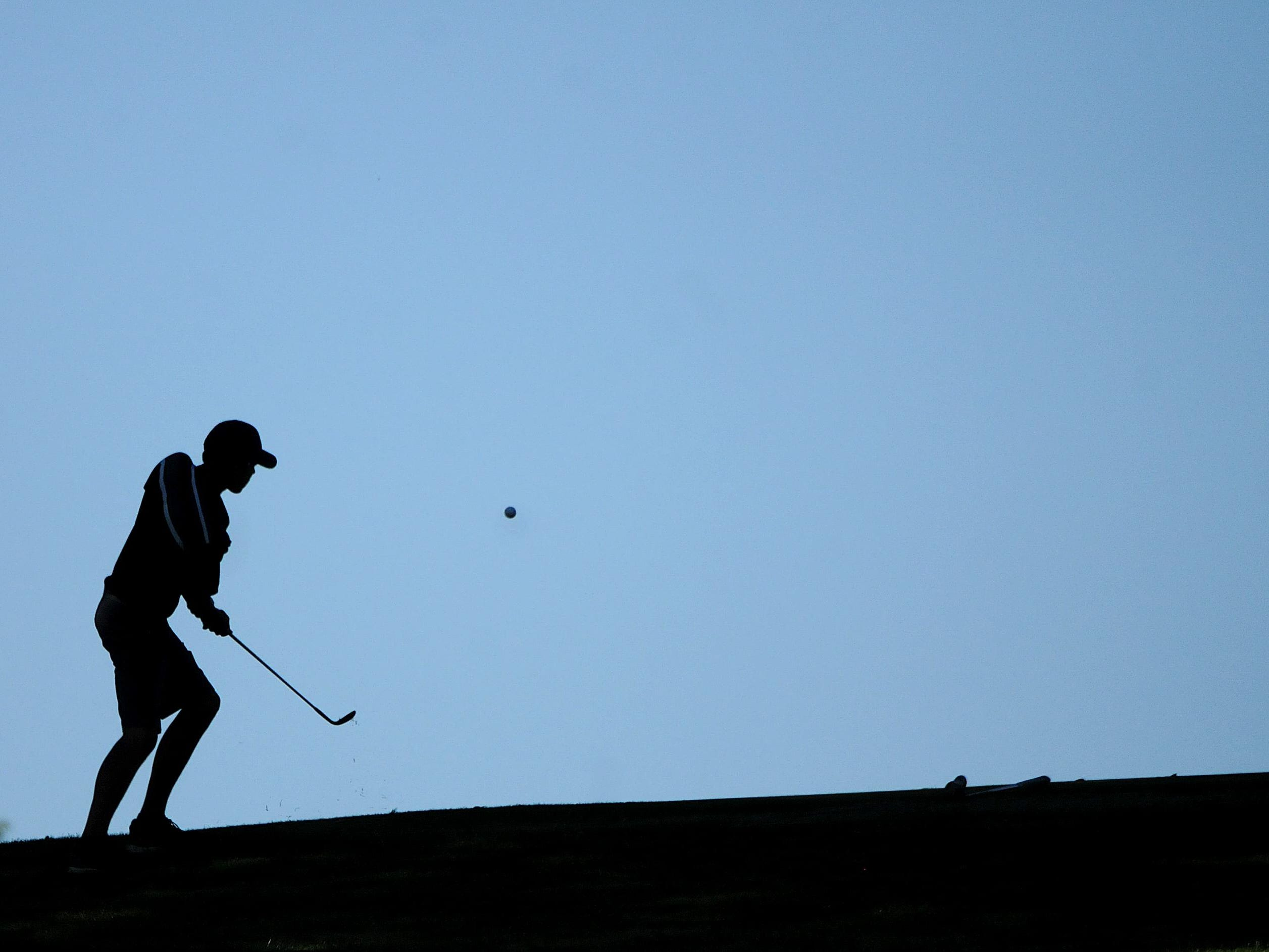 A golfer competes Tuesday in the Northern 10 Conference Golf Championship at Valley View Golf Course in Crestline.
