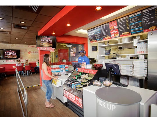 """Domino's will also open a """"pizza theater"""" in Cantonment. Highlights include indoor seating, open-area viewing of the food preparation process, as well as a child step so kids can see all of the action of pizza-making."""