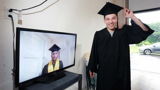 Brockton High School senior William Dragonetti, 18, watches the virtual Brockton High School graduation from his home, Saturday, June 27, 2020, as Senior Class President Raul Silva-Goncalves is seen sharing his message during the ceremony.