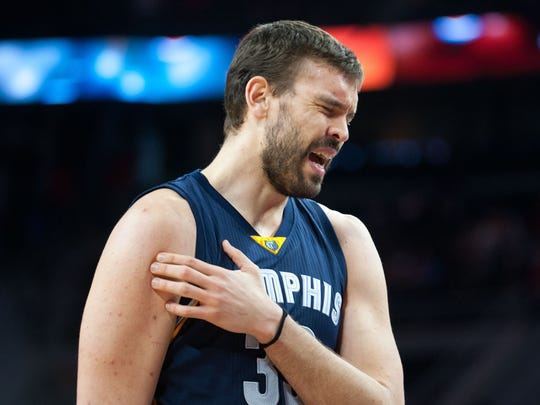 Memphis Grizzlies center Marc Gasol (33) reacts to pain during the fourth quarter against the Detroit Pistons at The Palace of Auburn Hills.