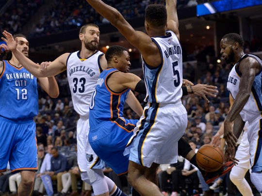 Oklahoma City Thunder guard Russell Westbrook (center) loses control of the ball while driving between Thunder center Steven Adams (12), Memphis Grizzlies center Marc Gasol (33), guard Andrew Harrison (5), and Grizzlies forward JaMychal Green (right) in the first half of an NBA basketball game on Thursday, Dec. 29, 2016.