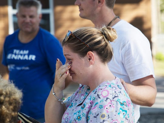 Kassandra Stafford wipes away tears while thanking volunteers with Builder's Care at her North Fort Myers home. The home was renovated to fit the needs of her disabled son, Victor. He was critically injured in a car crash that killed his mother. Kassandra has since adopted him.