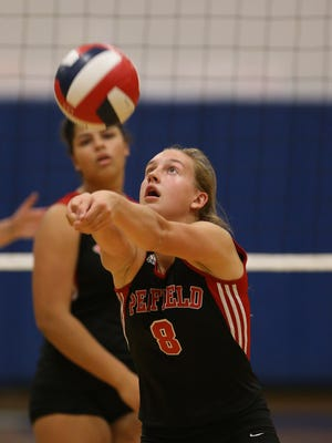 Penfield's Alea Steigerwald sets the ball against Victor in October 2016.