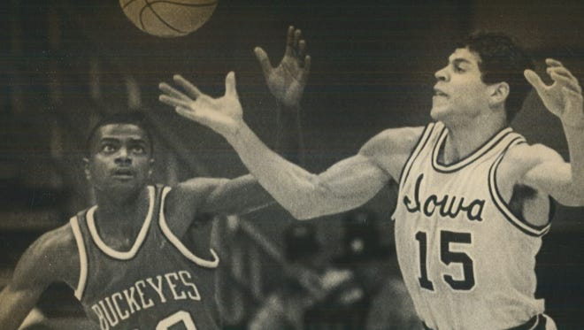 Iowa's Steve Carfino, right, battles for the ball against Ohio State's Curtis Wilson in 1984.