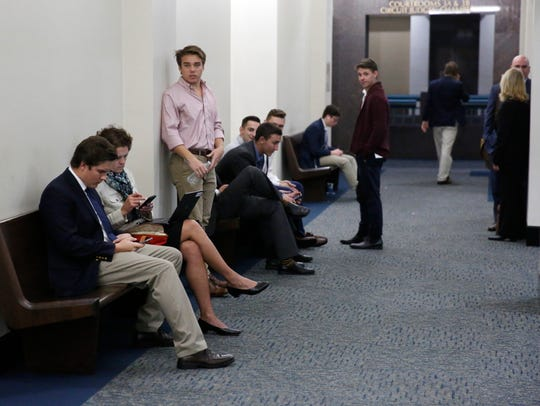 FSU students wait in the halls at the Leon County Courthouse