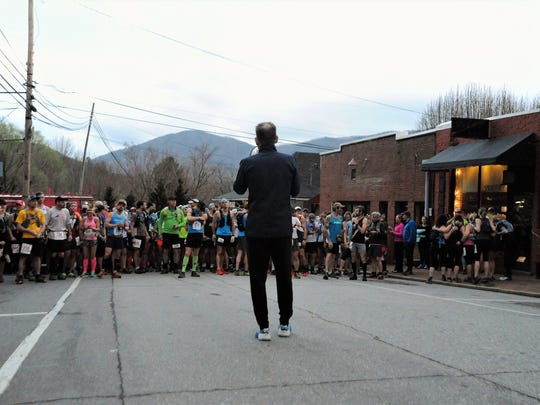 Race director Jay Curwen gives instructions to runners on Cherry Street before the 2018 Mount Mitchell Challenge and Black Mountain Marathon. Hundreds of runners will return to the site on Feb. 23, for the 22nd running of the races.