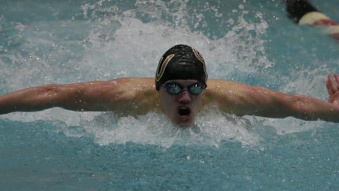 Green Bay United sophomore Kaiser Neverman swims in the 100-yard butterfly Saturday at the WIAA Division 1 Boys State Swimming and Diving Championships at the University of Wisconsin Madison's Natatorium
