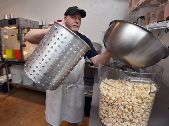 Ken Busby works on a fresh batch of popcorn at The Popcorn Place on Old Fannin Road in Flowood.