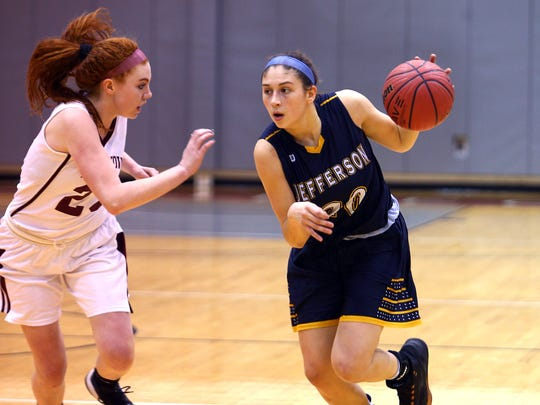 Jefferson's Taylor Langan drives down court vs. Morristown