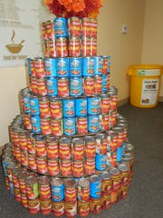 A tree made of cans of food is on display at the kickoff