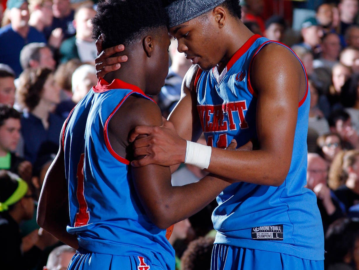 Everett's Jamyrin Jackson, right, talks with Nyreel Powell late in the fourth quarter against East Lansing after Powell forced a turnover during their regional final game Wednesday, March 16, 2016, at Mason High School. Everett won, 54-48.