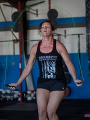 Crystal Moel, of Cape Coral, jumps rope as part of