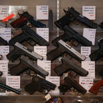 Hand guns on display at The Pawn Shop on Friday, Jan.