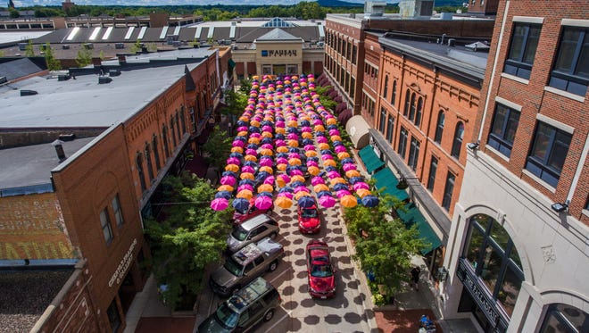 Colorful umbrellas hang above Third Street in downtown Wausau as part of a summer display. The photo was taken by a camera-equipped drone.