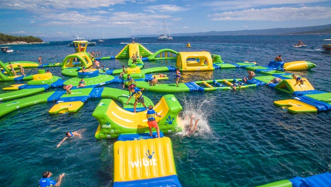 Whoa Zone floating water park is set to open June 24 at Whihala Beach in Whiting, Indiana.