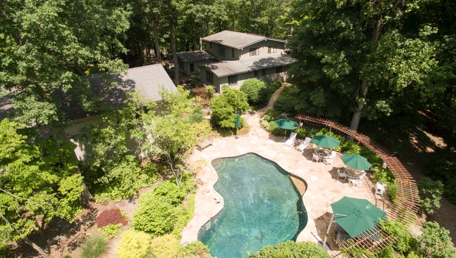 This 6.5-acre estate in Harding has a contemporary home with walls of windows, garages for six cars and a pool and koi pond with a waterfall and babbling brook.