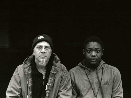 This photo by Anthony Bachelier, a student in Manifest's first Intro to black and white photo class, shows instructor Michael Wilson and a Madisonville resident.