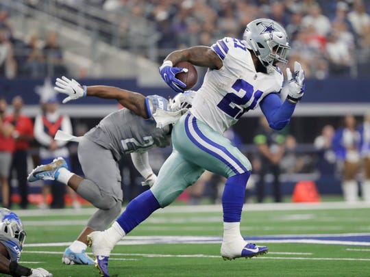 Dallas Cowboys running back Ezekiel Elliott (21) carries past Detroit Lions cornerback Quandre Diggs, left,in the second half of an NFL football game in Arlington, Texas, Sunday, Sept. 30, 2018. (AP Photo/Eric Gay)