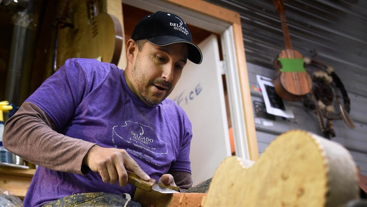 Manuel Delgado of Delgado Guitars works in his shop