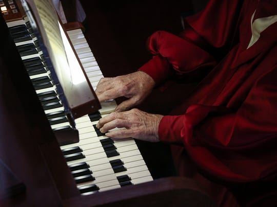 Fred Briegs plays the organ at the White Church in Woodbridge on Sept. 20, 2015. Briegs is retiring as music director at the church after 55 years.