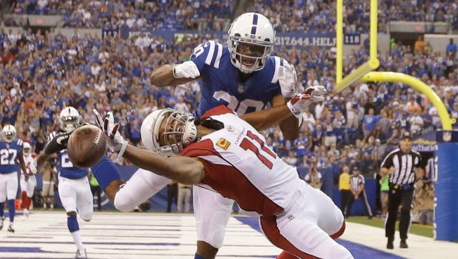 Larry Fitzgerald attempts to catch a fade from Carson Palmer in the first half vs. the Colts.