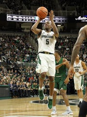Michigan State Spartans guard Cassius Winston (5)takes a shot against the Cleveland State Vikings during the second half of a game at Jack Breslin Student Events Center.