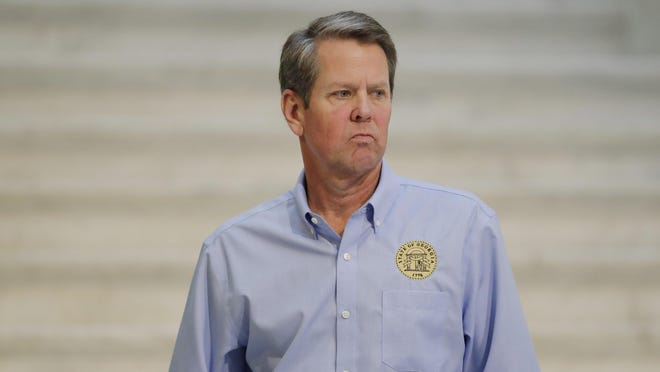 FILE - In this Wednesday, April 8, 2020, file photo, Georgia Gov. Brian Kemp walks away after speaking during a news conference at the state Capitol in Atlanta.