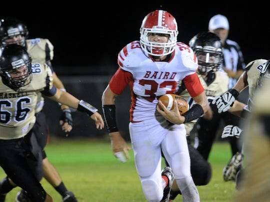 Baird running back Seth Porter, 33, runs past the Haskell defense during a game in 2015.
