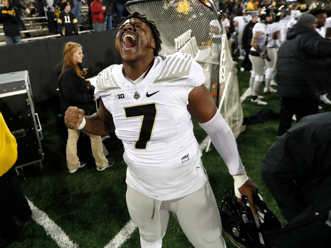 Purdue defensive tackle Eddy Wilson celebrates at the