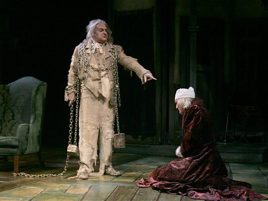 "The ghost of Jacob Marley (Gregory Procaccino) warns his former business partner Ebenezer Scrooge (Bruce Cromer) to change his ways in the Playhouse in the Park's 21st annual production of ""A Christmas Carol"" in 2011."