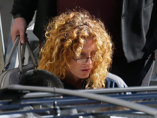 Tonya Couch is escorted to a waiting vehicle after
