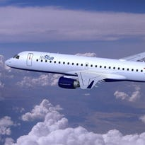 This undated file photo shows an image of a JetBlue Embraer E190 jet.