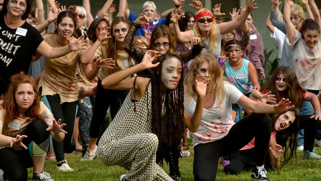 Harris-Jackson, front left, and Amanda Salgado, both juniors at California Lutheran University, get the front spot in the finale of in the Thrill the World synchronized zombie dance held Saturday on the CLU campus.