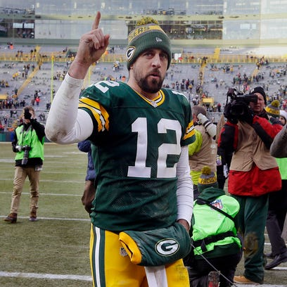 Aaron Rodgers acknowledges fans after the Green Bay